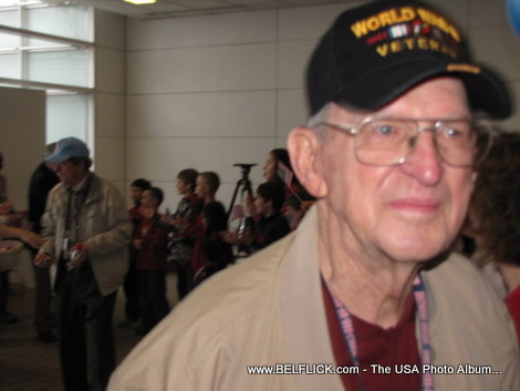 A real live World War II veteran greeting passengers at Washington Dulles Airport