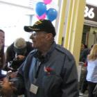 World War II veteran greeting passengers at Washington Dulles Airport